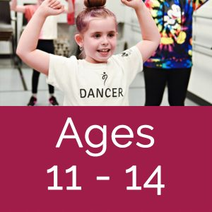 kids in dance class, fists pumps in air above their heads